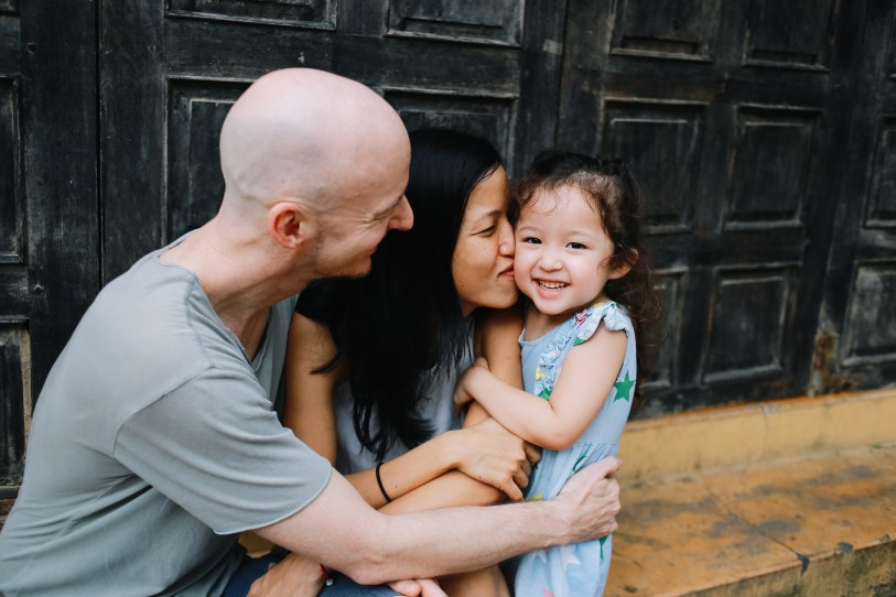 happy family in hoian taken by vietnamese family photographer