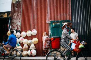 street life with love taken by hoi an photographer - vietnam wedding photographer in hoi an